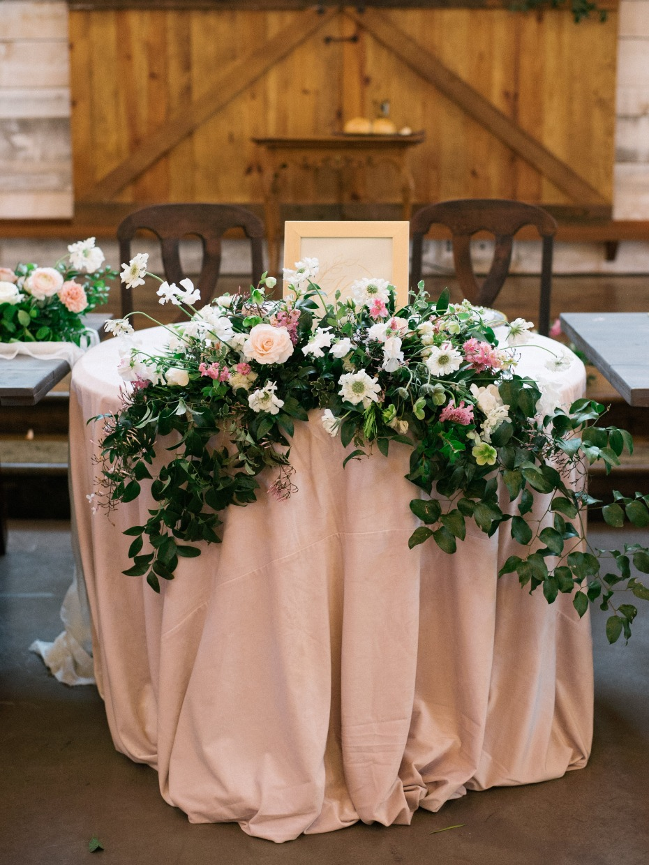 soft blush sweetheart table with cascading floral decor