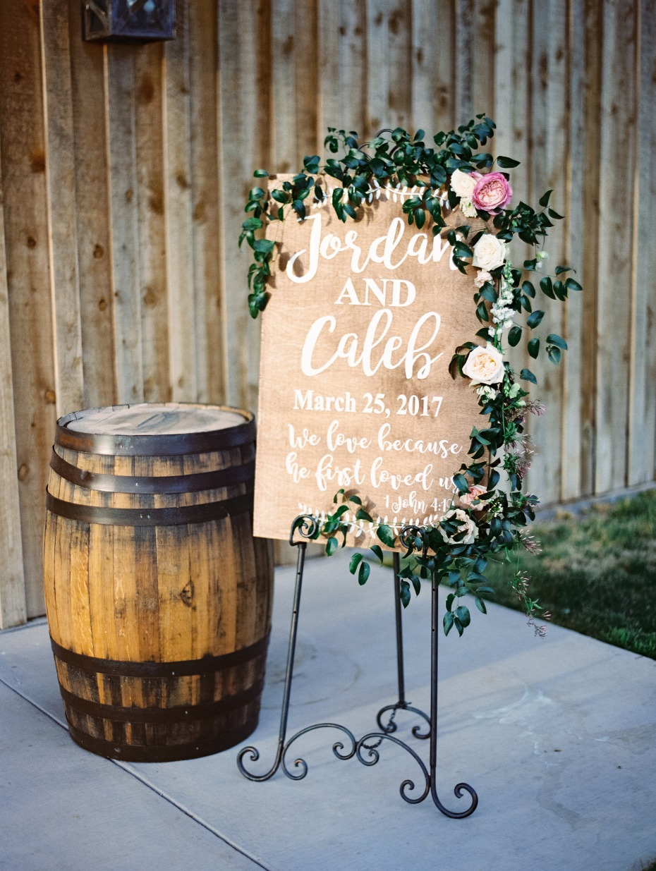 romantic floral draped wedding sign