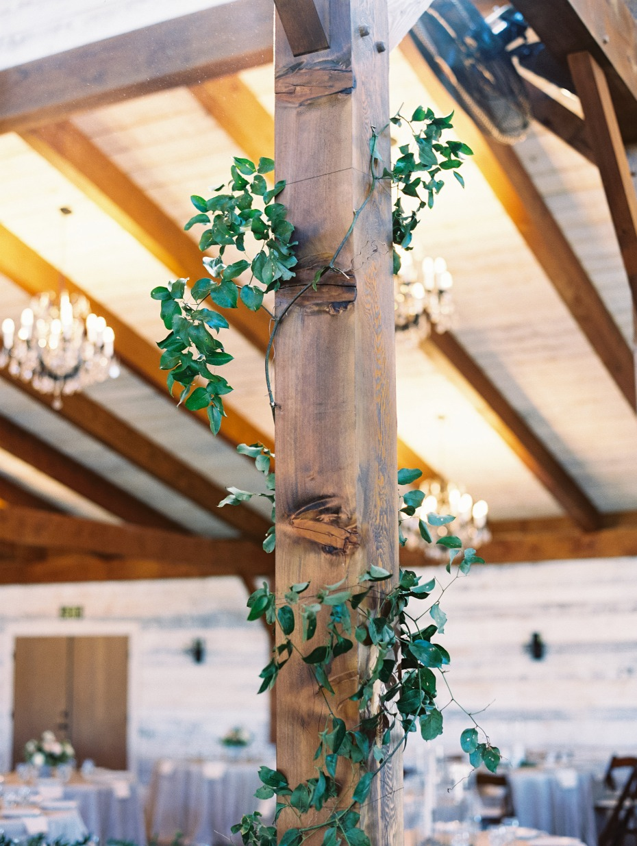 wrapping the rustic beams of the venue in ivy