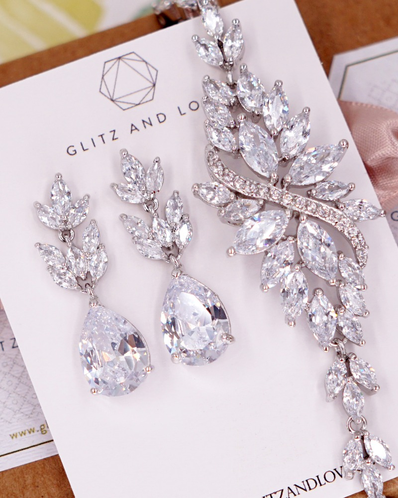 Silver marquise leaf cubic zirconia jewelry set. Earrings and Bracelet. Simple and timeless. Available in rose gold and silver. Shop