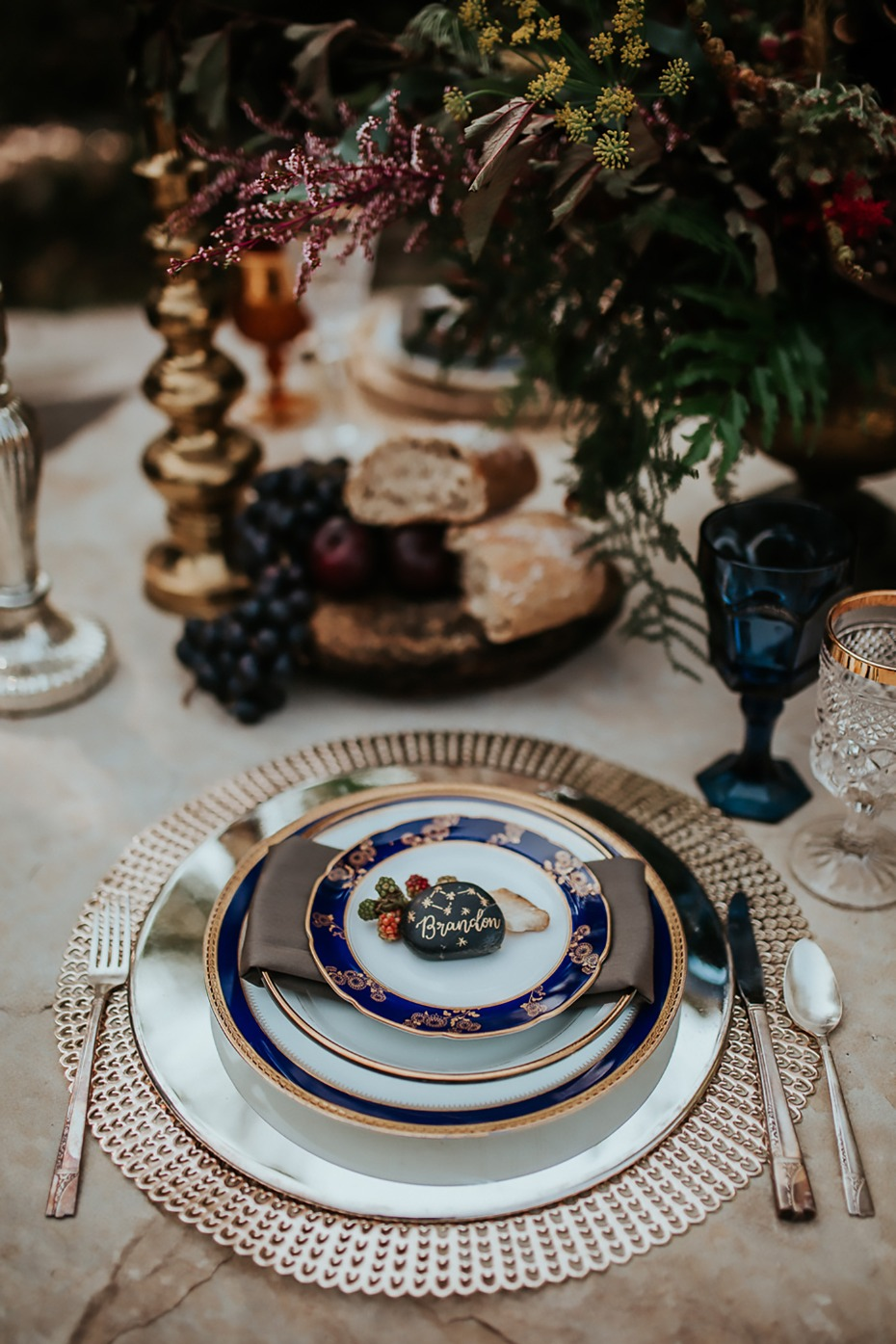 silver gold and blue wedding place setting