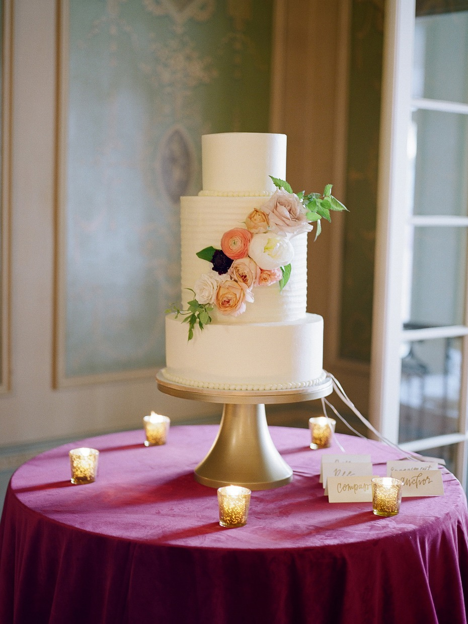 classic white wedding cake with floral accents