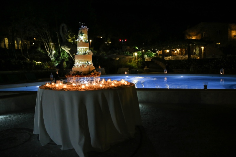 A stunning wedding cake in a picturesque location at Valle di Badia, an ancient hamlet in Tuscany for weddings, holidays and ceremonies