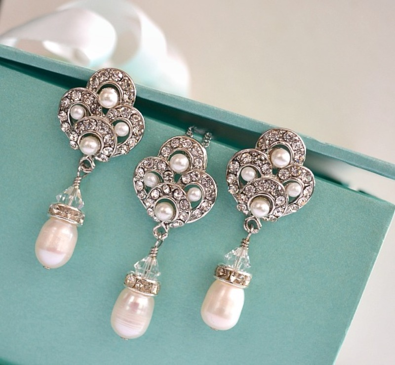 Freshwater pearl bridal jewelry set in an art deco design feature pair of earrings and a matching necklace in ivory white freshwater