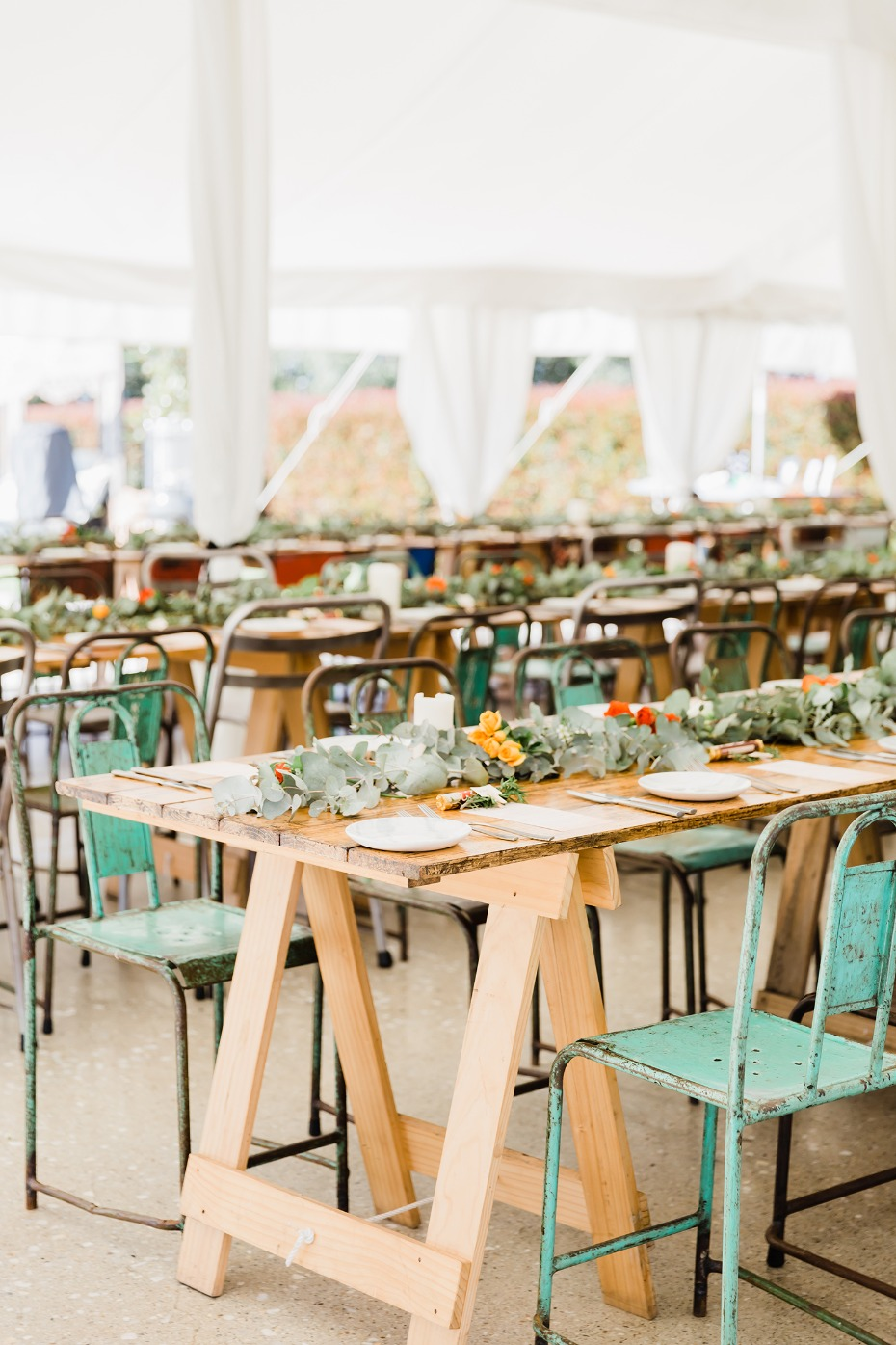 mismatched wedding seating for your tented wedding reception