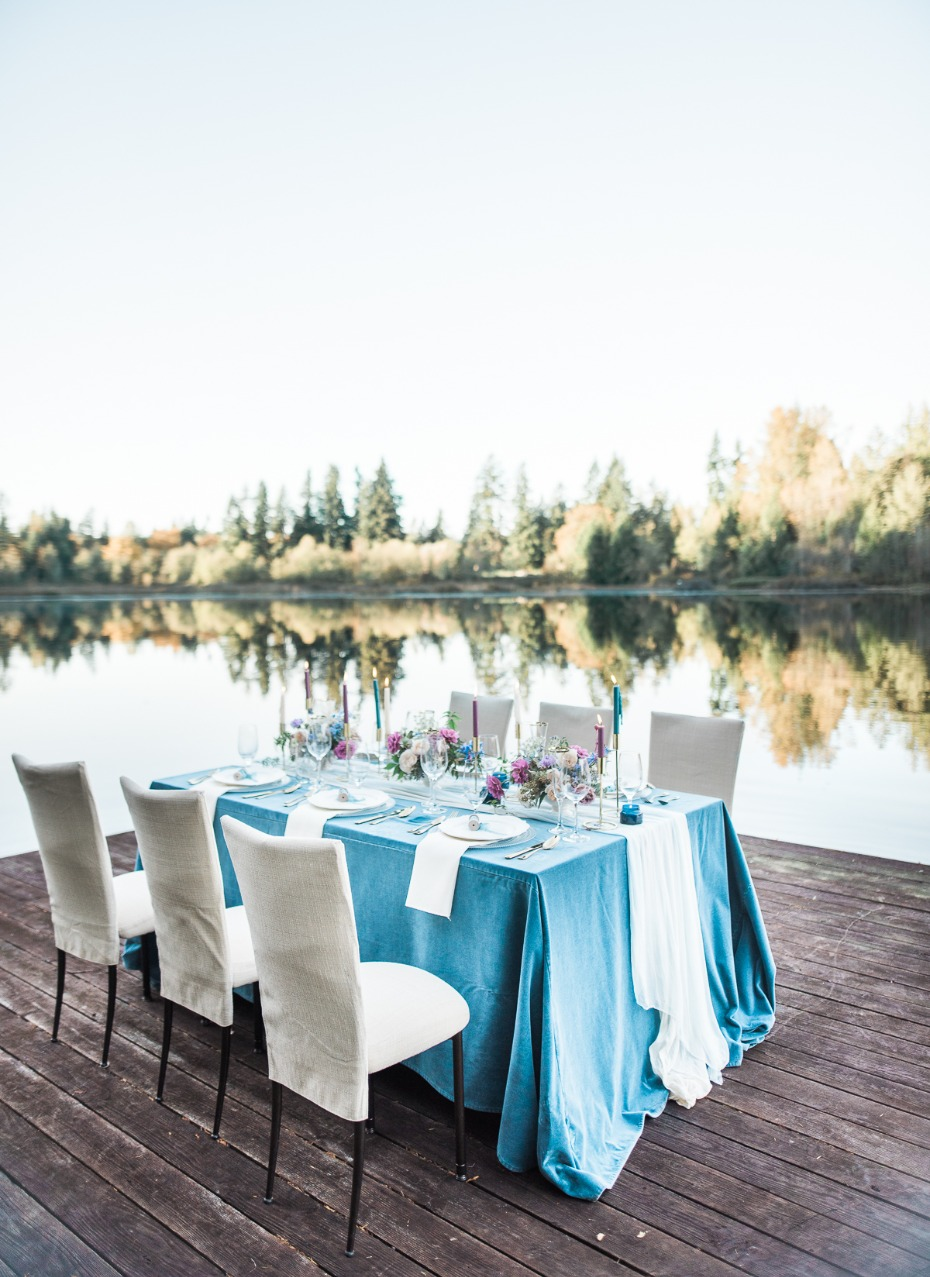Lakefront reception table with blue linens