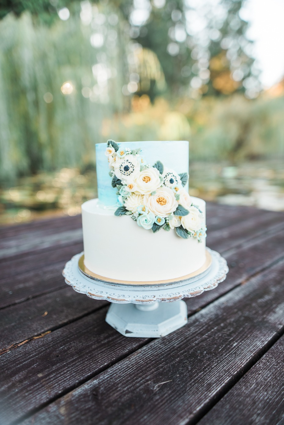 Blue watercolor cake with sugar flowers
