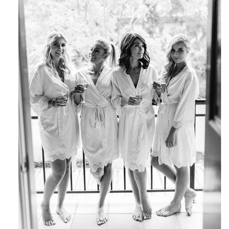 Gorgeous ladies all in white wearing our 'Touch of Lace' robes 💕