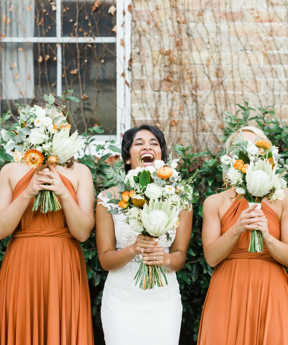 bride and her bridesmaids rocking burnt orange twist wrap dresses