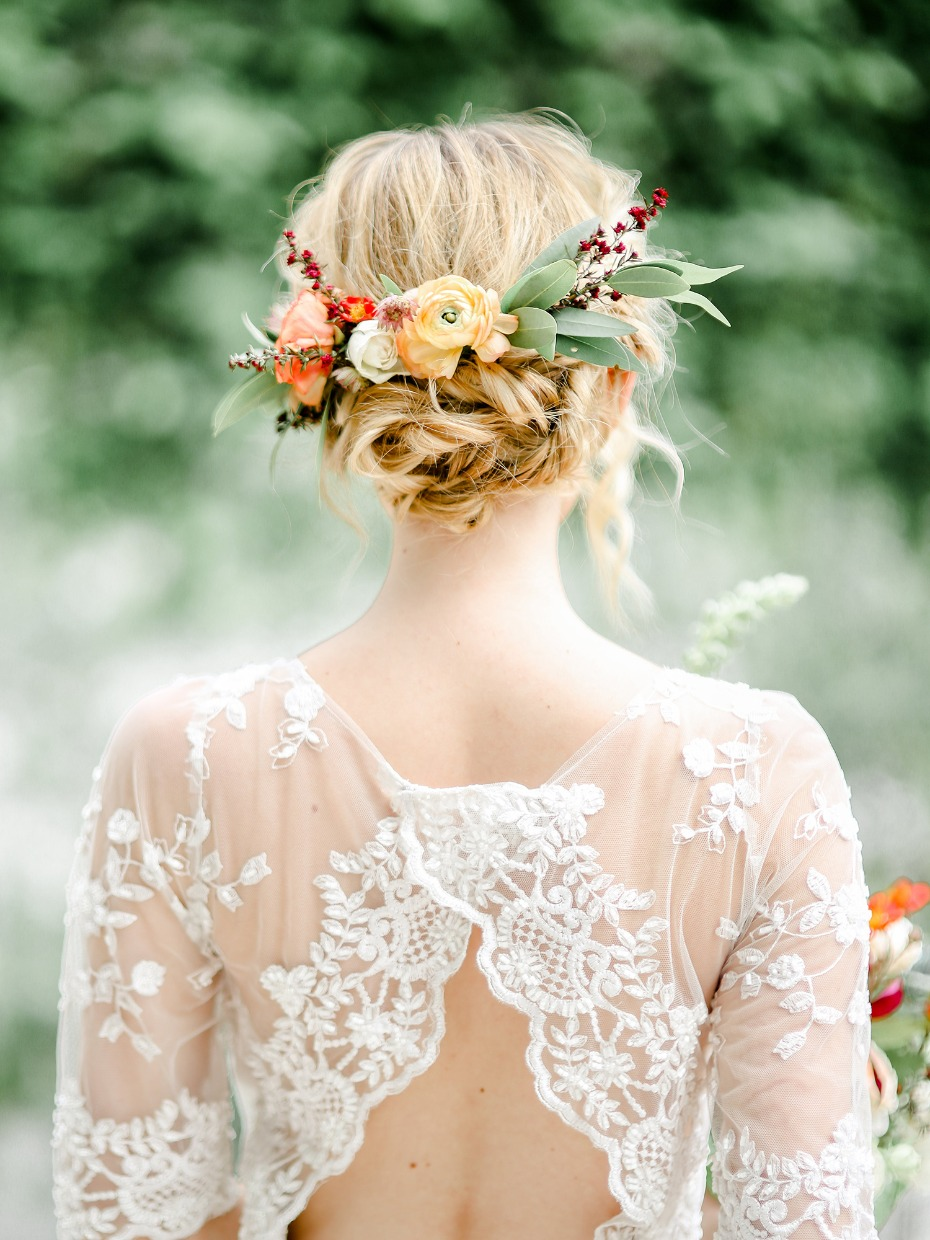 wedding updo with bright floral accents