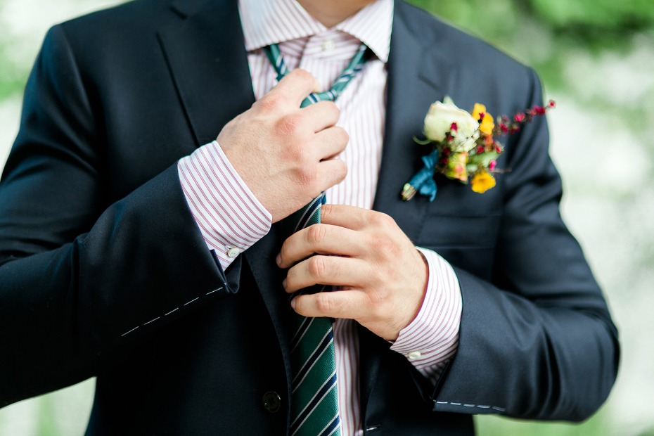 groom in red and green stripes with a modern cut navy suit