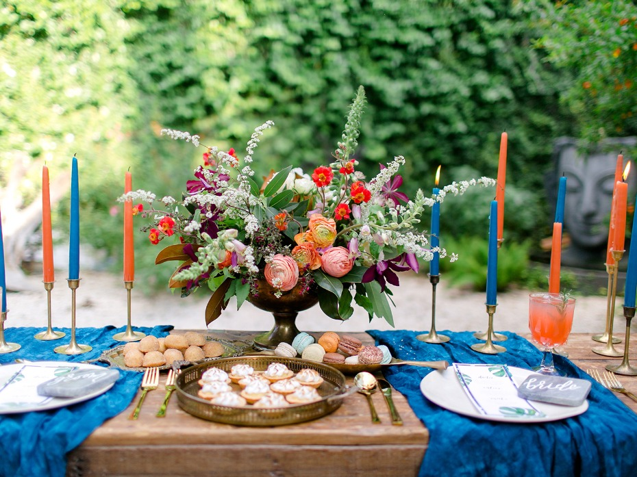 bright blue and orange wedding sweetheart table decor