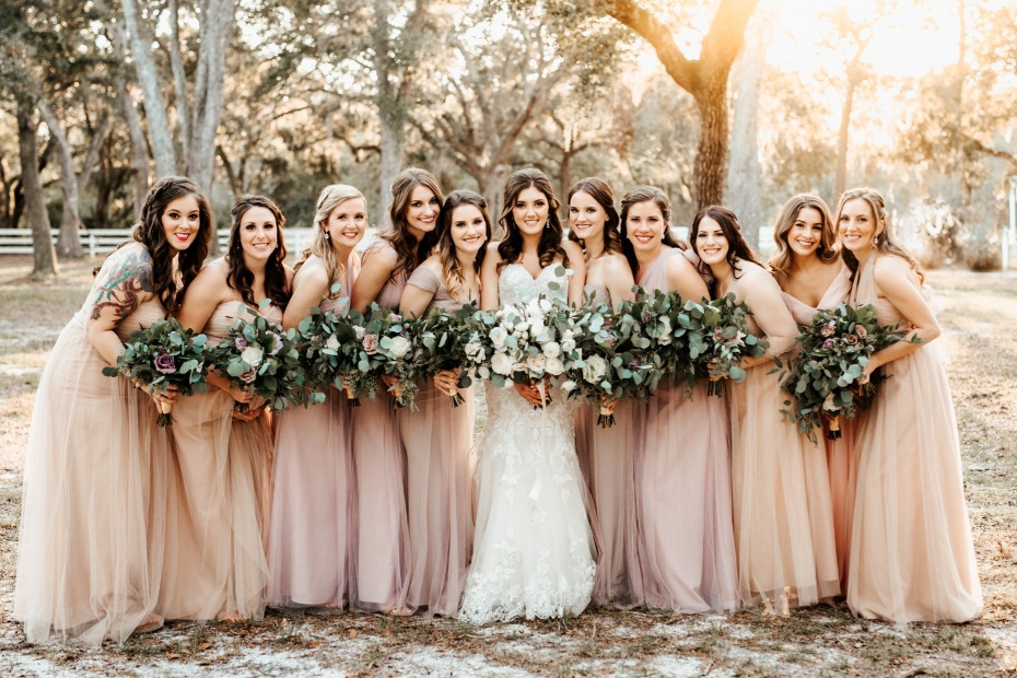 Soft bridesmaid dresses in blush and peach