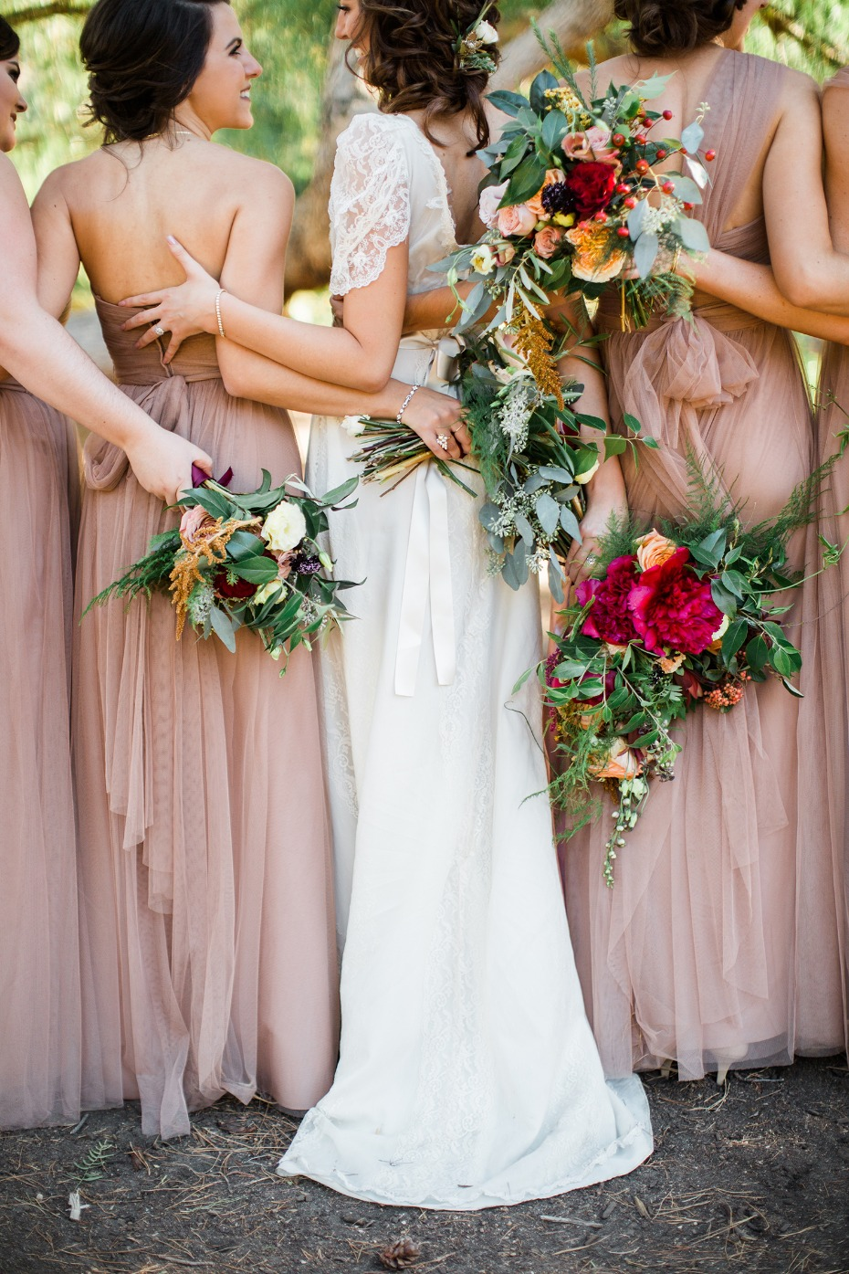 Bridal party in matching brown sugar bridesmaid dresses