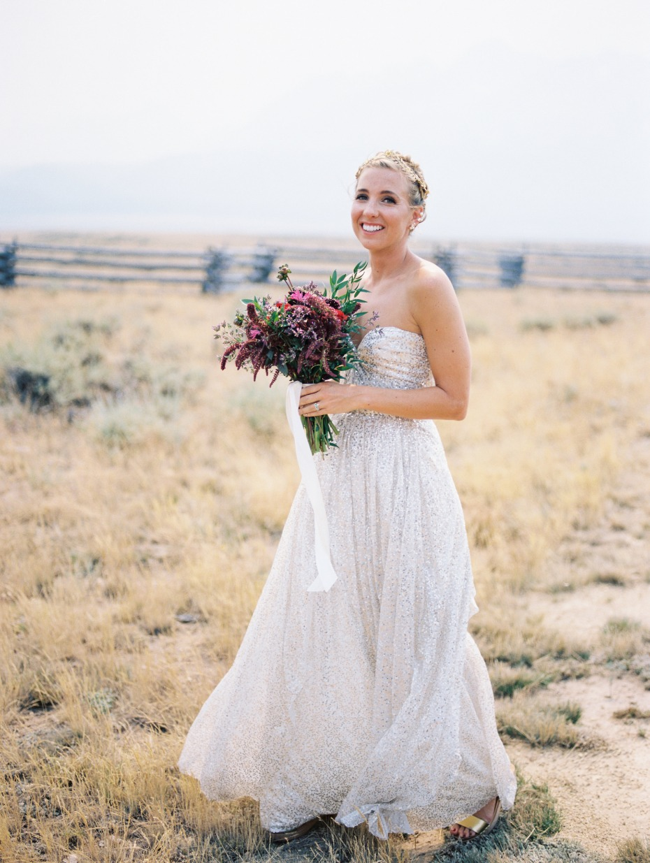 bride with wild flower burgundy bouquet