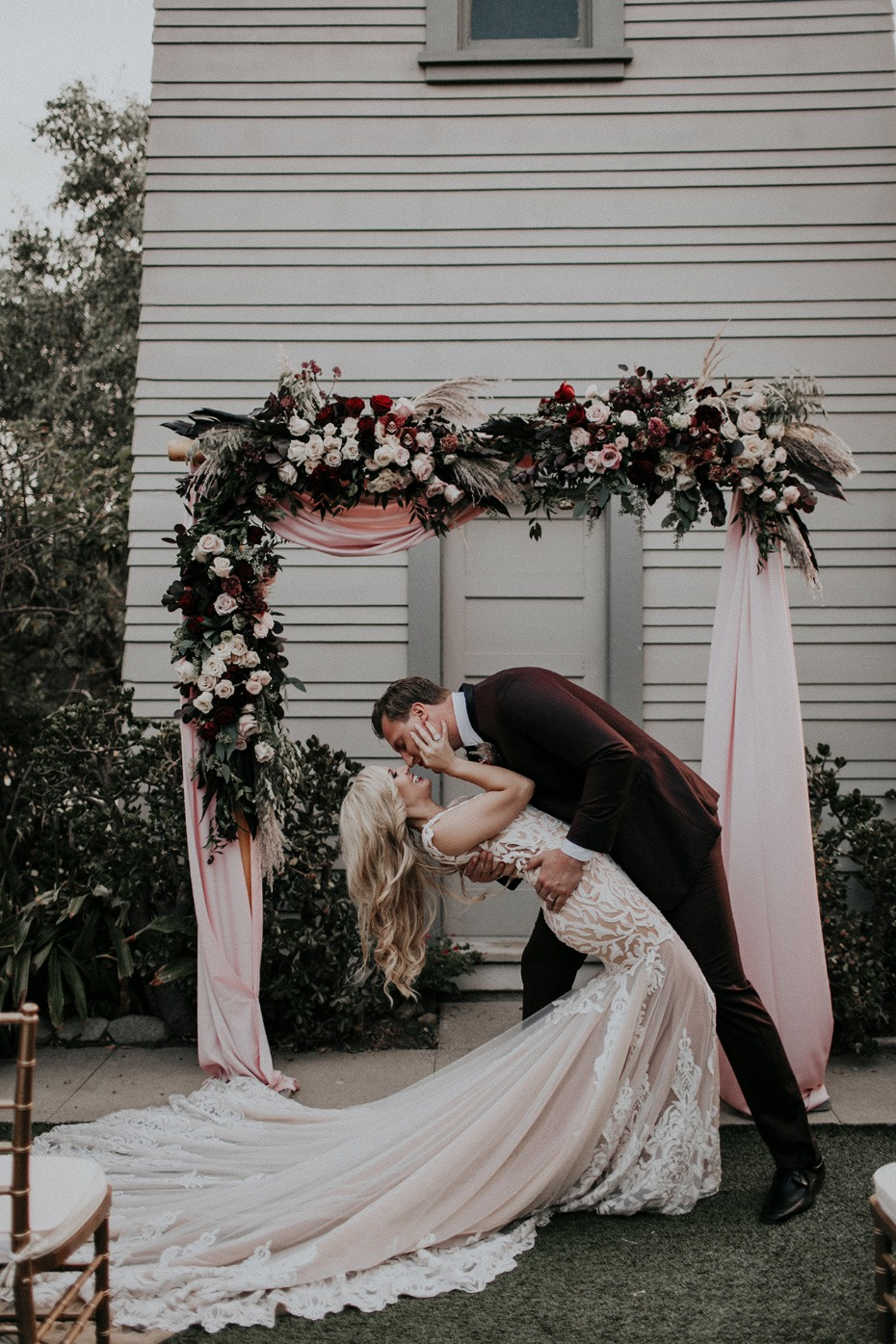 Blush and burgundy ceremony