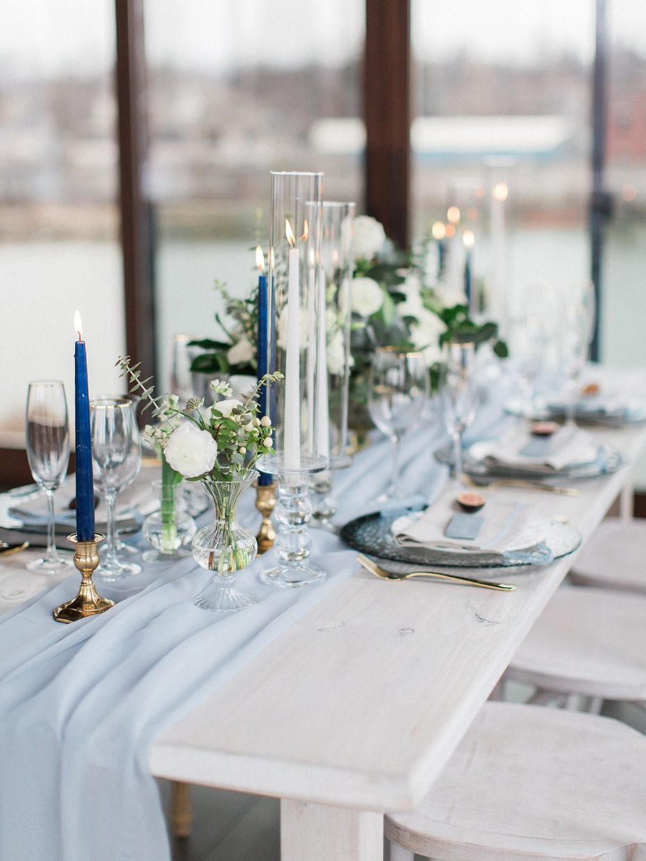 soft blue and white table decor with gold accents