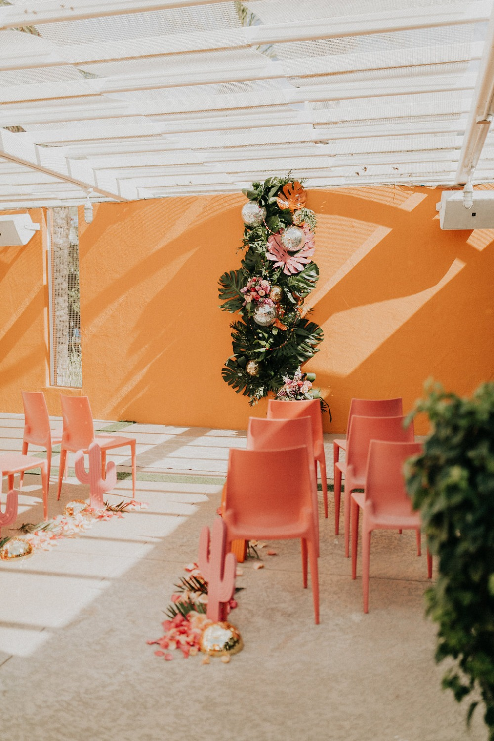 neon desert themed wedding ceremony decor