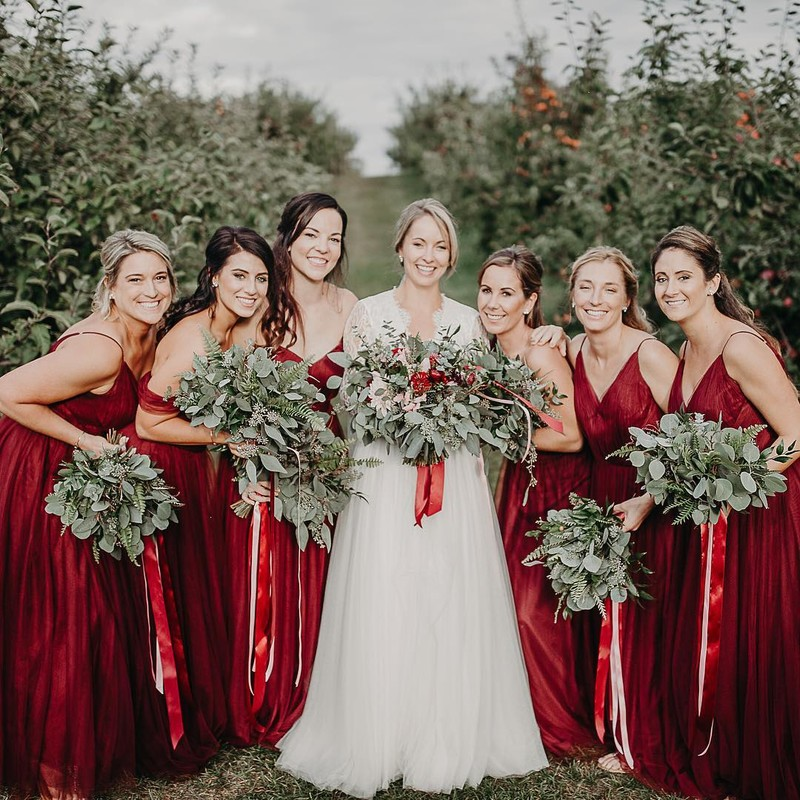 Girls in red dresses with flowy tulle sashes.❤️