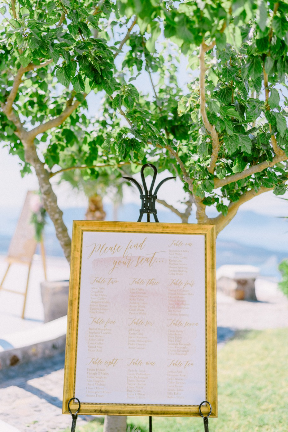 gold calligraphy and watercolor seating assignment display