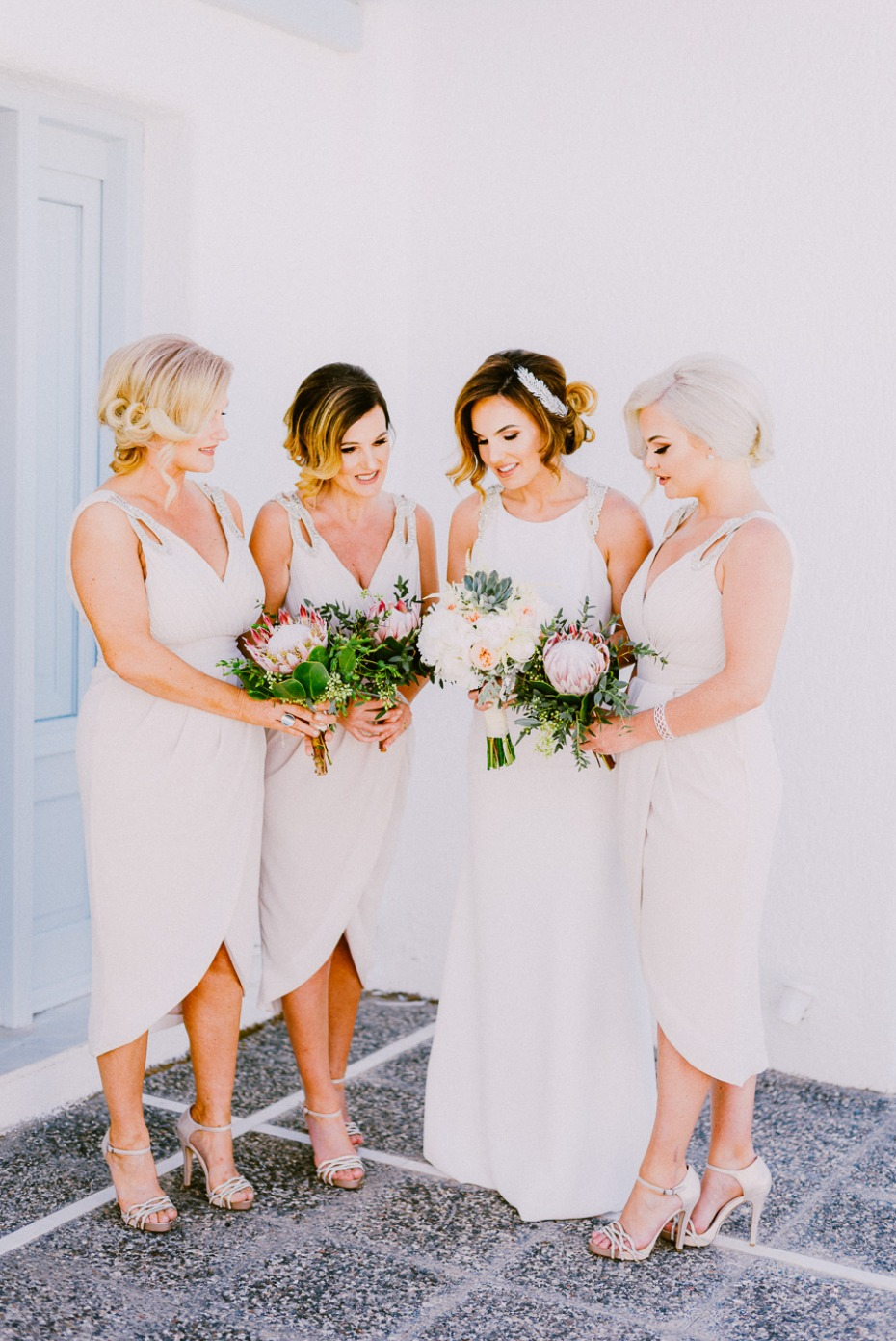 bride and her bridesmaids in white