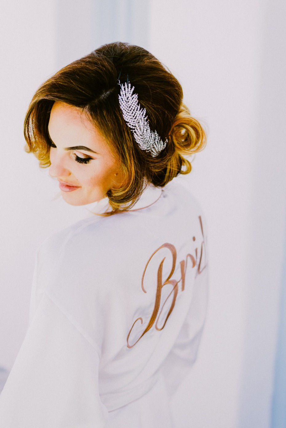 bridal getting ready look with elegant updo hair