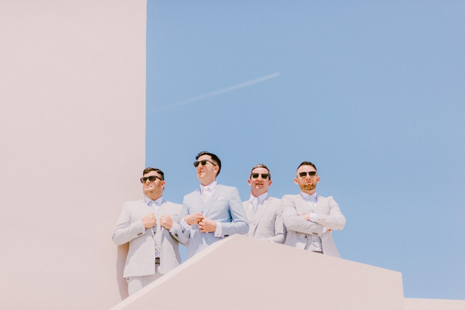 groom and his men in light blue and grey