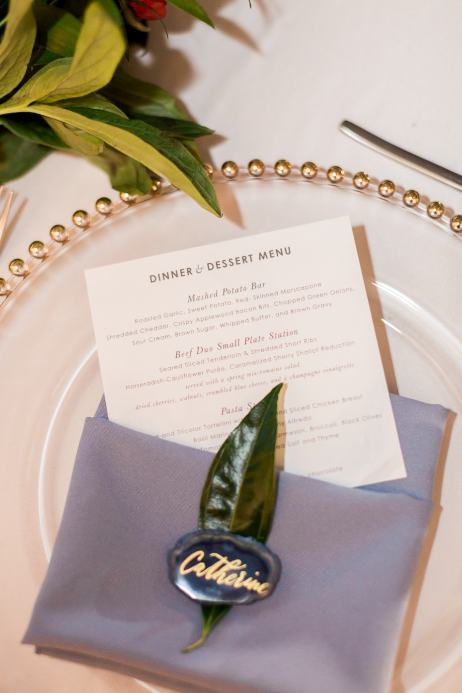 blue and gold wedding table setting with square menu