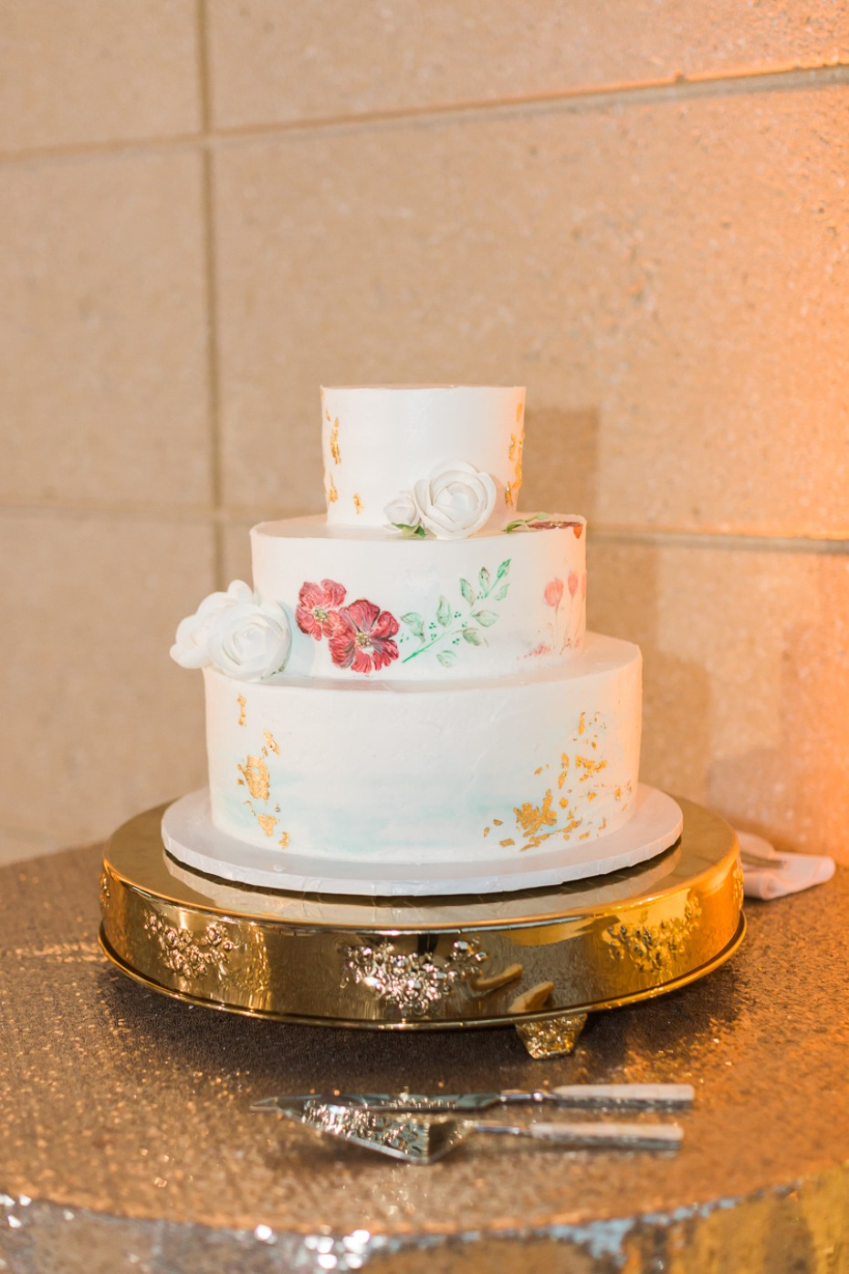 painted wedding cake with gold leaf accents