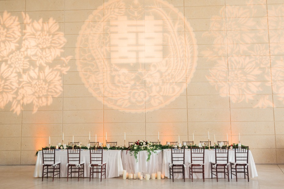 wedding party table with Chinese symbol for marriage projected behind it