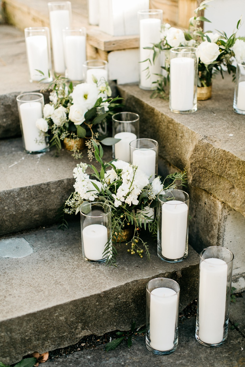 white flower and candle lined pathway