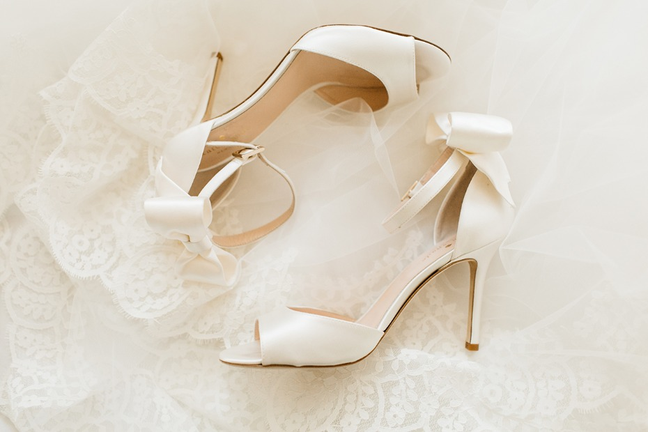 sweet all white wedding shoes with bows on the heels