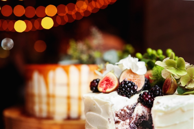 Gorgeous blueberry velvet wedding cake with blackberries and figs for intimate wedding at the Treno Pizza Bar in New Jersey