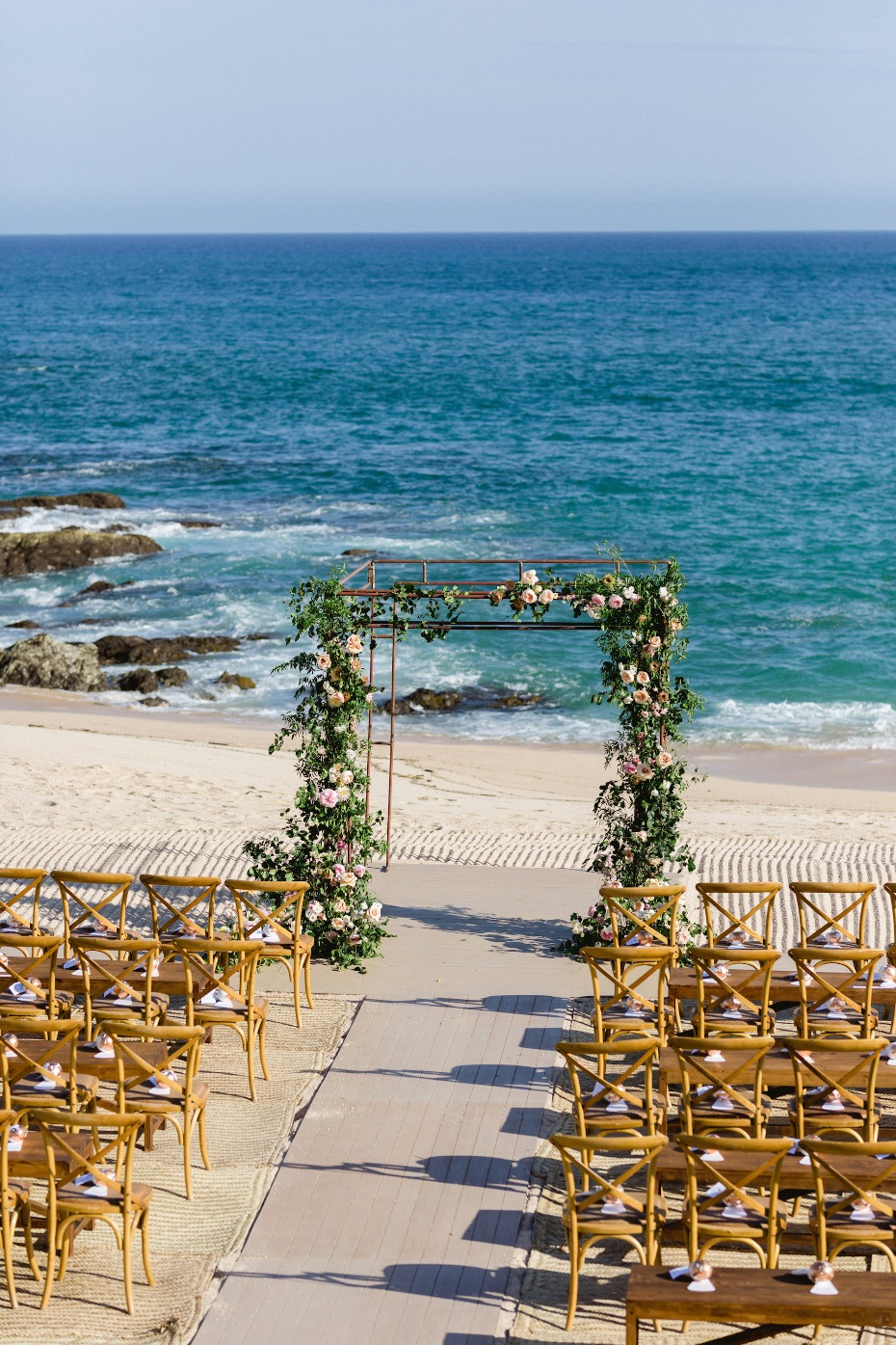 Flower arch ocean front wedding in Mexico