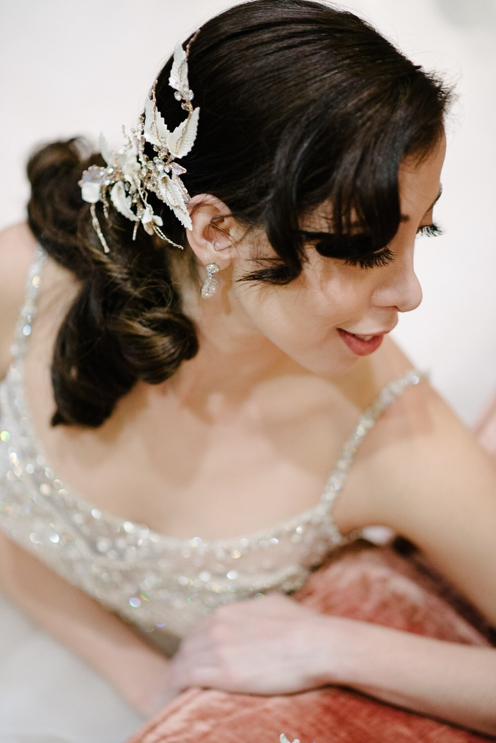 swooped back wedding hair and elegant hair piece