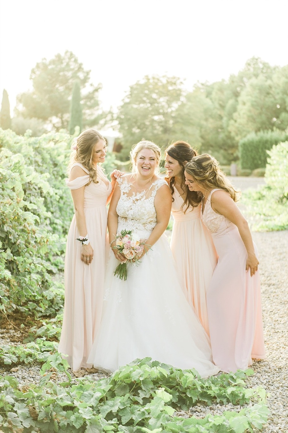 soft peach bridal party in golden sunlight