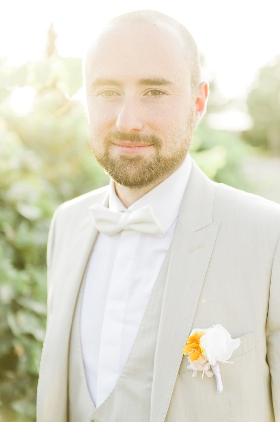handsome groom in sand colored wedding suit
