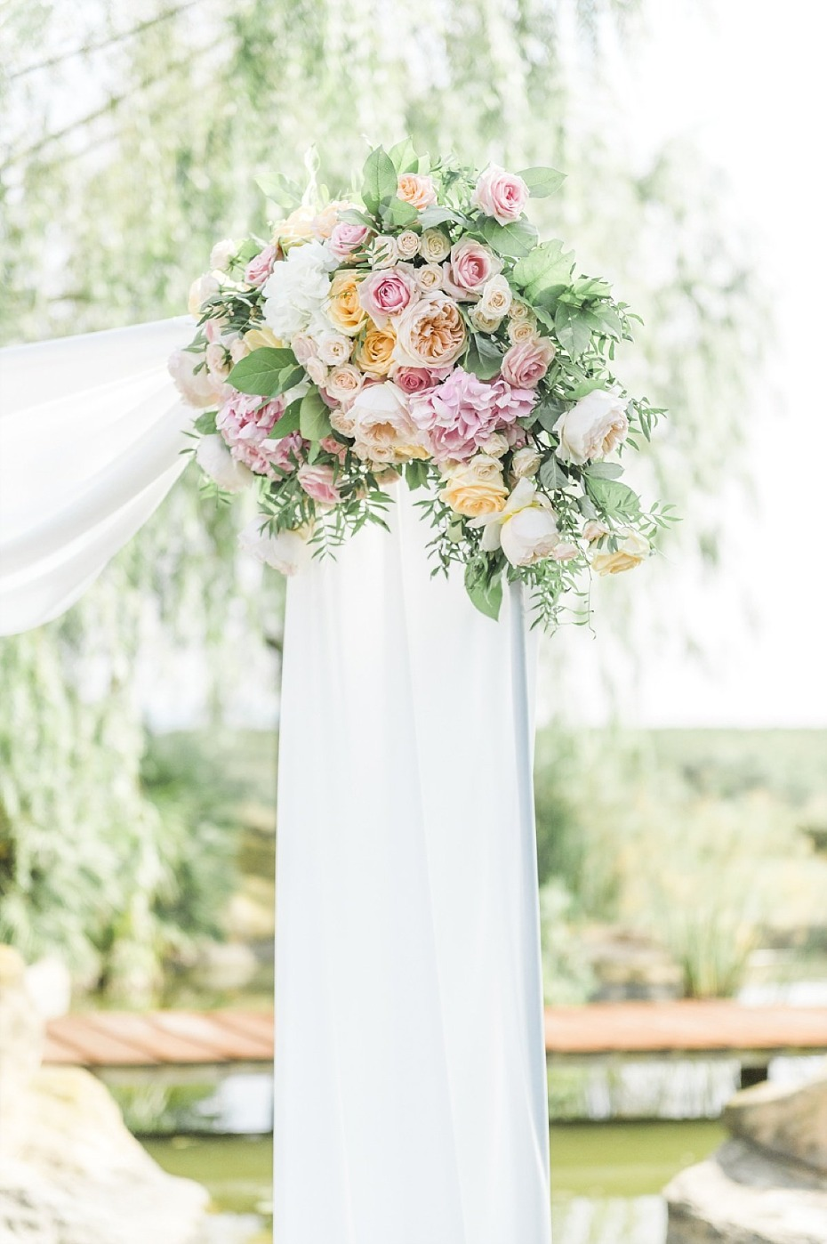 floral accented wedding arch