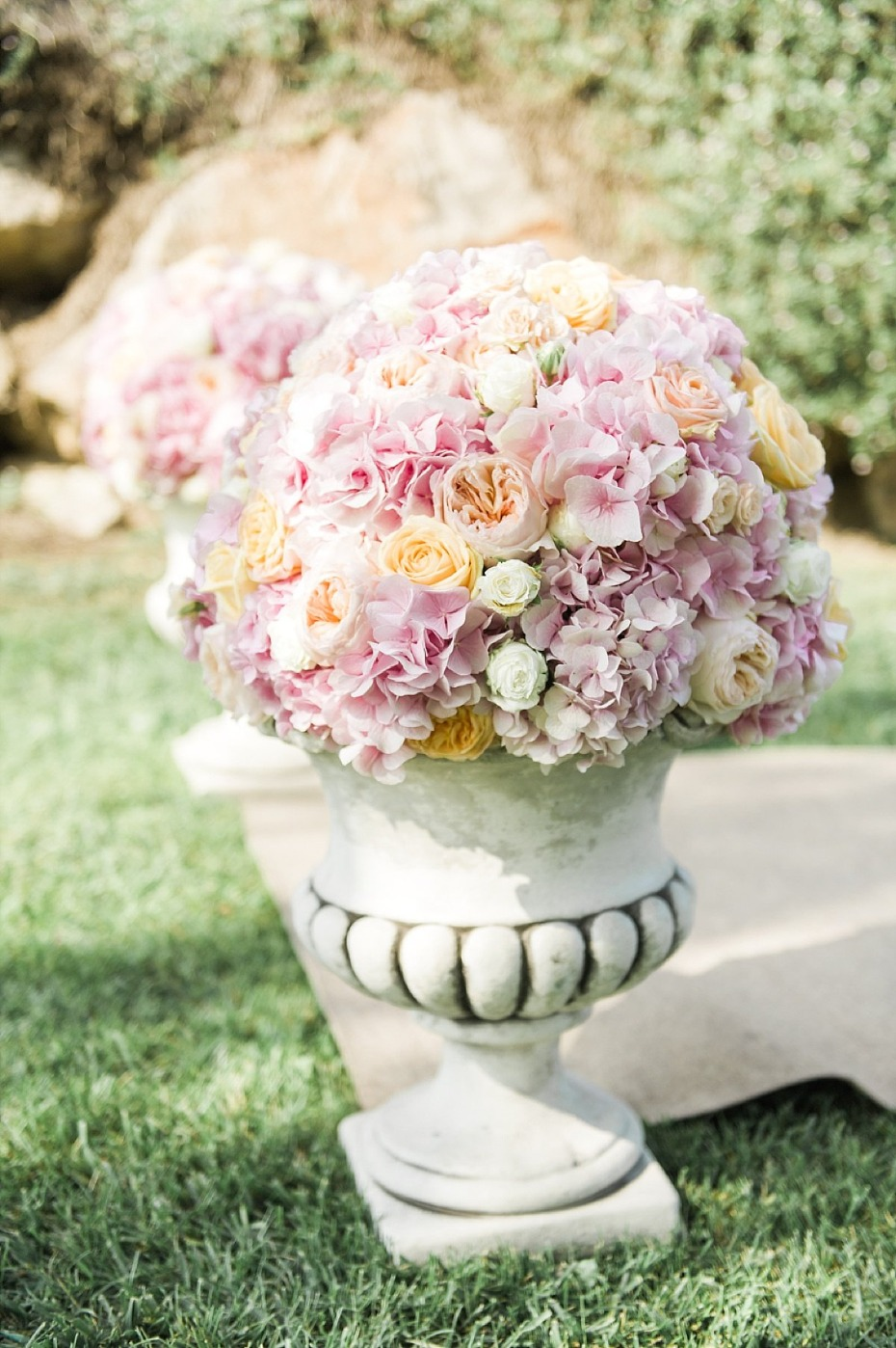 pink and peach potted floral arrangements