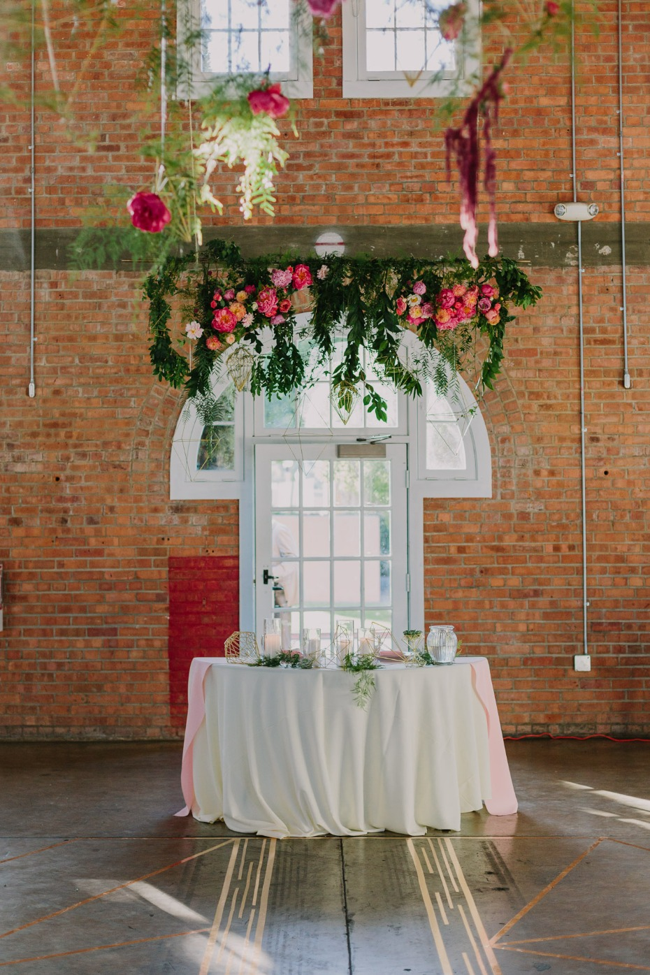 Love the flowers above this sweetheart table