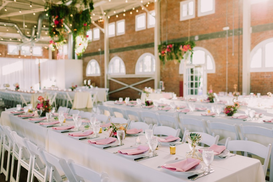 Cheerful reception space with pink and white linens