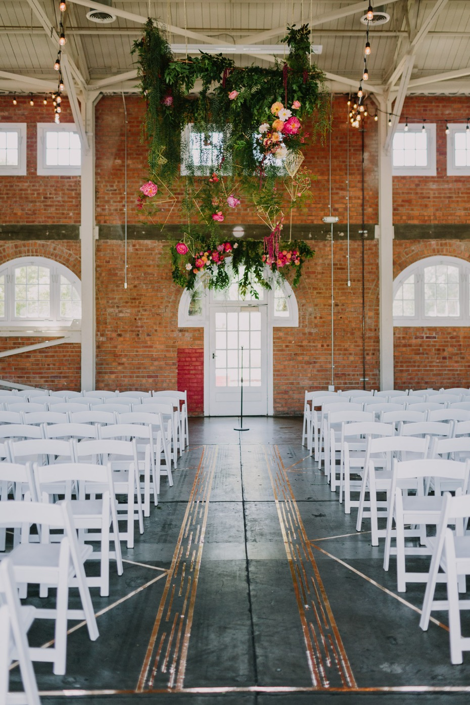 Open and airy ceremony space with greenery