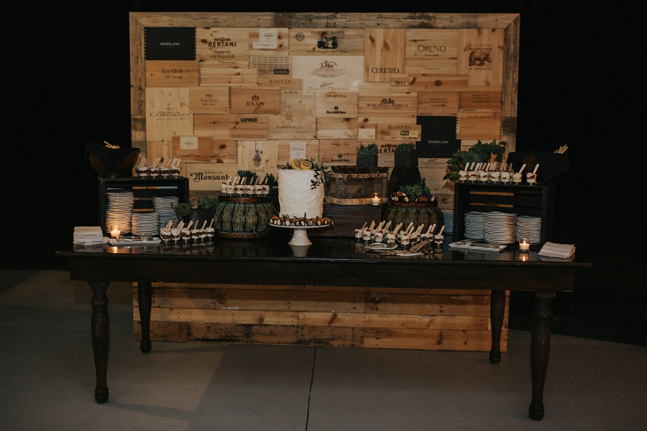 dessert table with wine box backdrop
