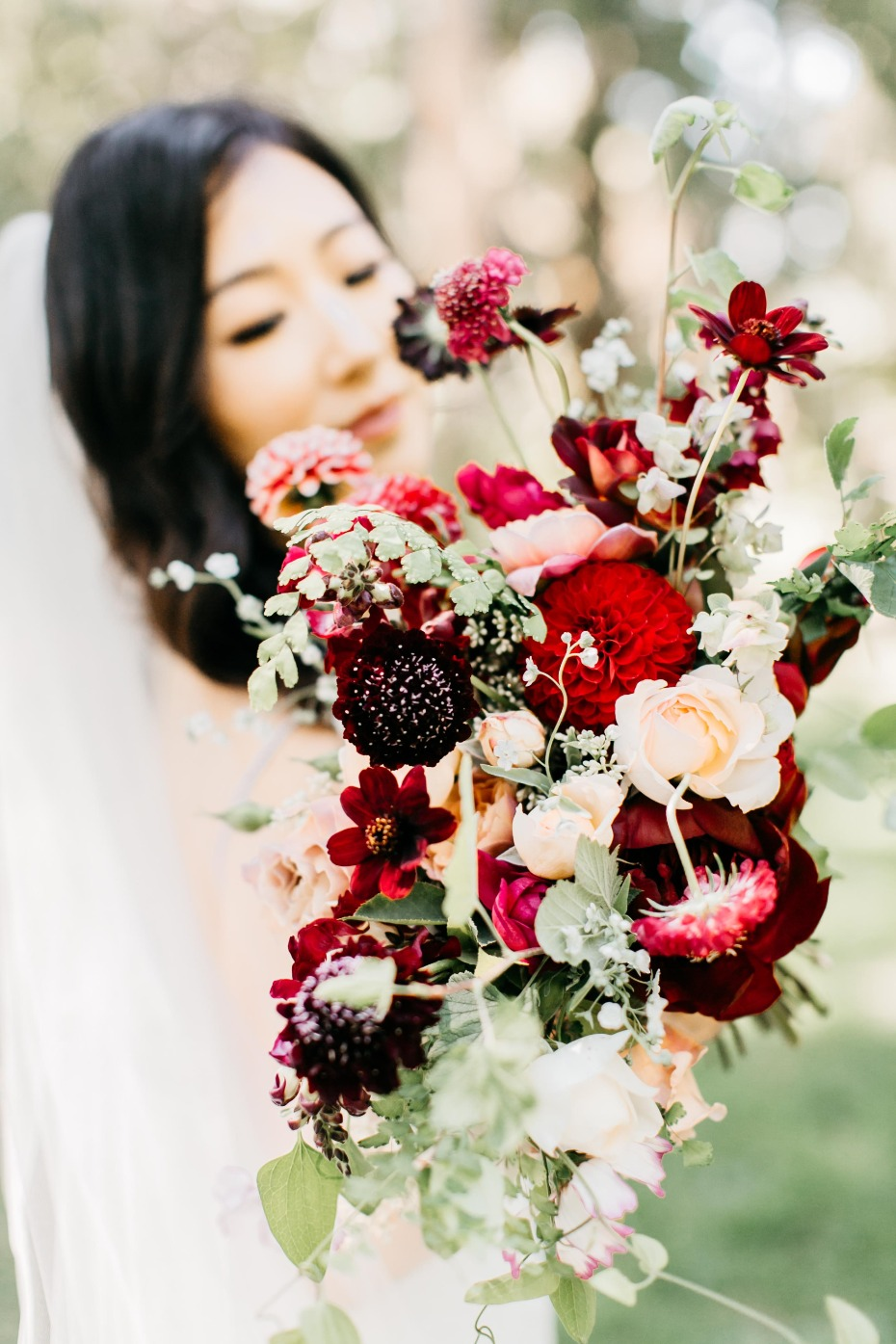 red and burgundy wildflower style bouquet