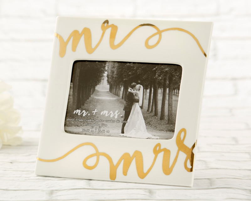 The perfect wedding gift for displaying moments from the happiest day of your life, our Ceramic Mr. & Mrs. Frame is a simple, meaningful