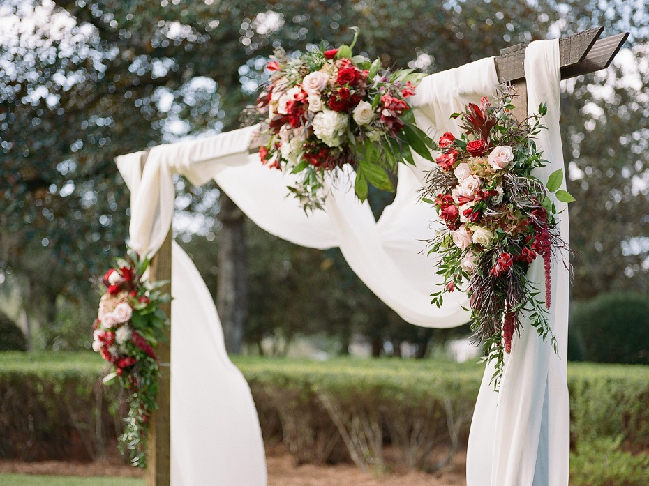 romantic floral accented wedding arch