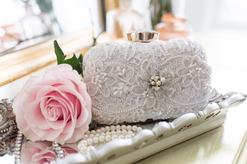 Small couture bridal clutches designed from a vintage jewel