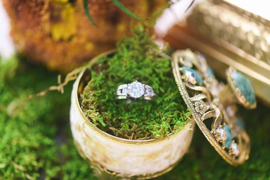 wedding ring in moss filled wedding ring box