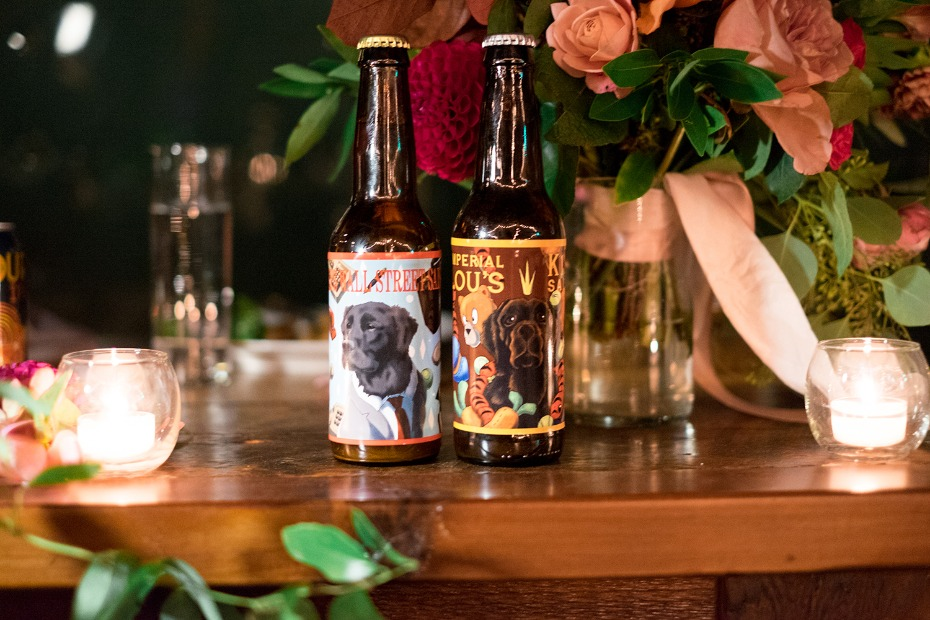 homemade wedding beer with custom labels depicting the bride and grooms dogs