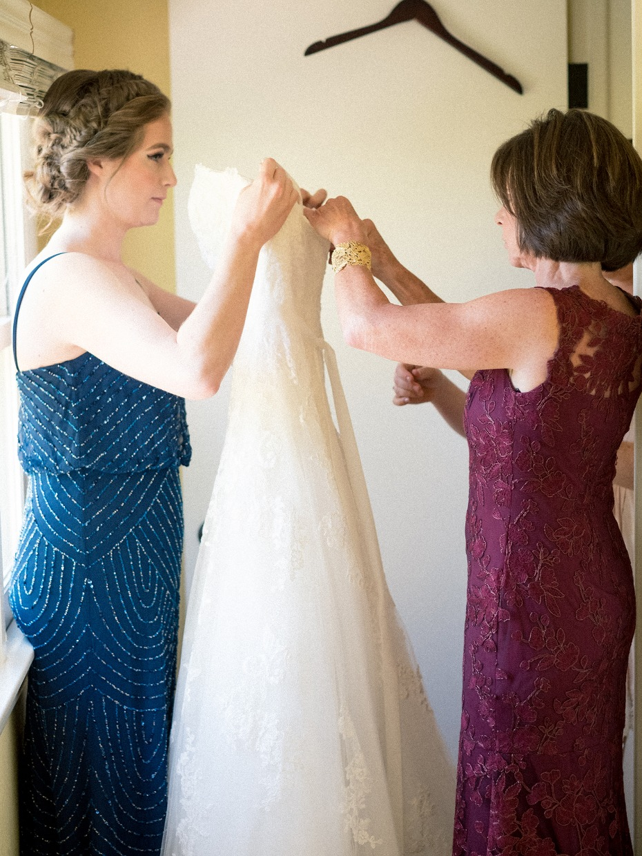getting the dress ready for the bride